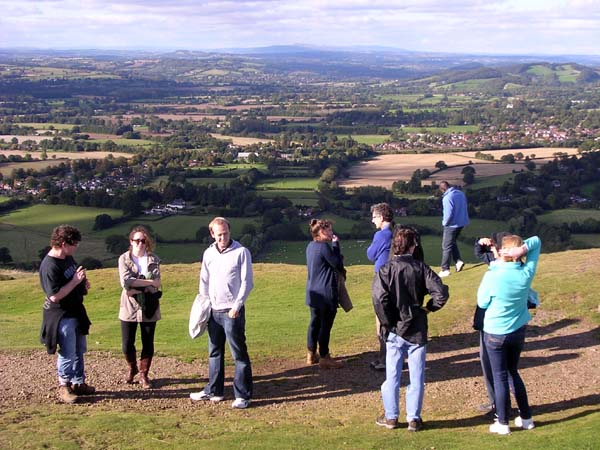 A group on a hillside with a view far into the distance