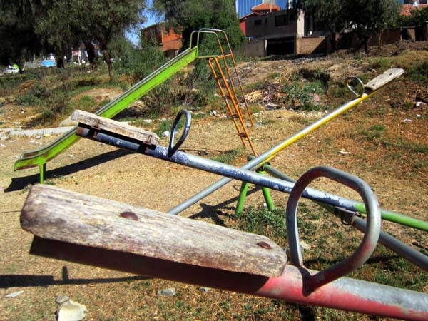 A playground with seesaws in disrepair