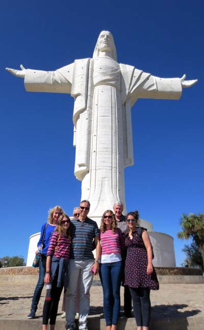 The team in Cochabamba at the foot of a statue of Christ