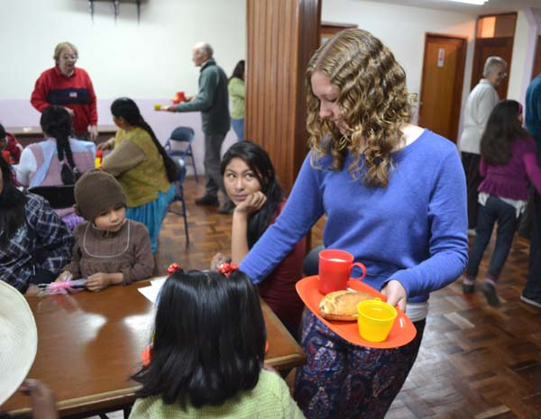 Beccy helping to serve breakfast to needy people in La Paz