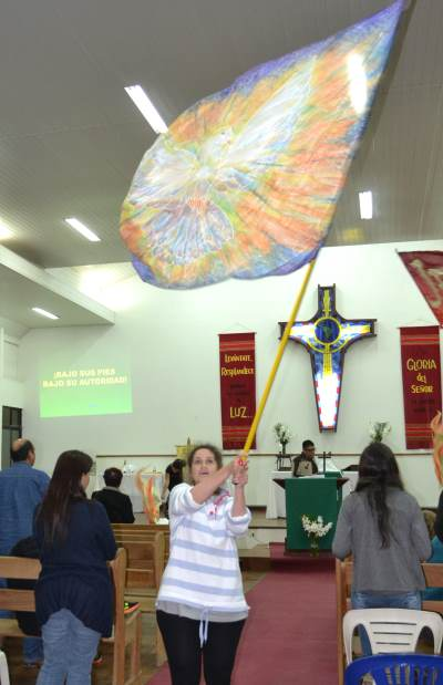Emily waving a giant worship flag