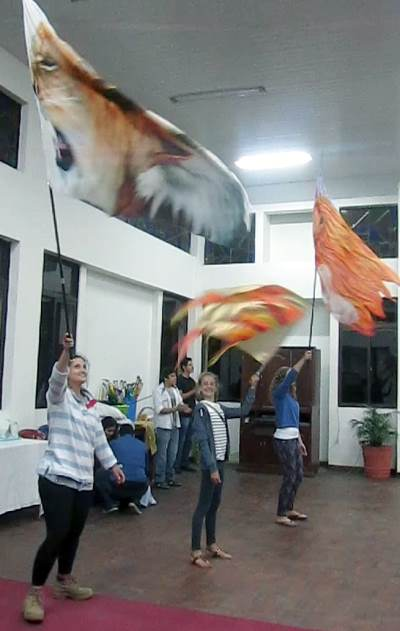 Team members waving giant worship flags
