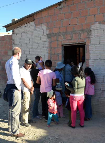 A group outside a rough brick building