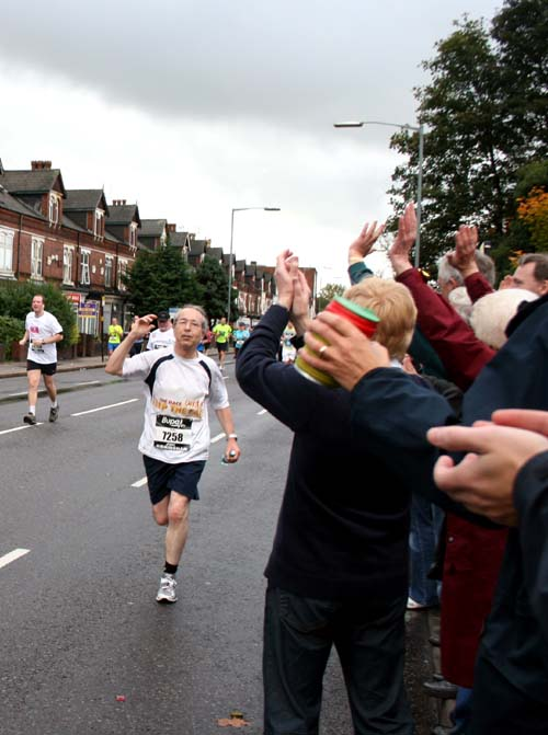 A runner is applauded going past Christ Church