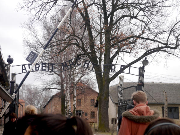 Sign over the entrance to Auschwitz I: Arbeit macht frei
