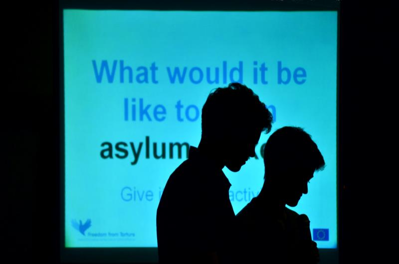 Silhouettes of bowed heads: What would it be like to be an asylum seeker?