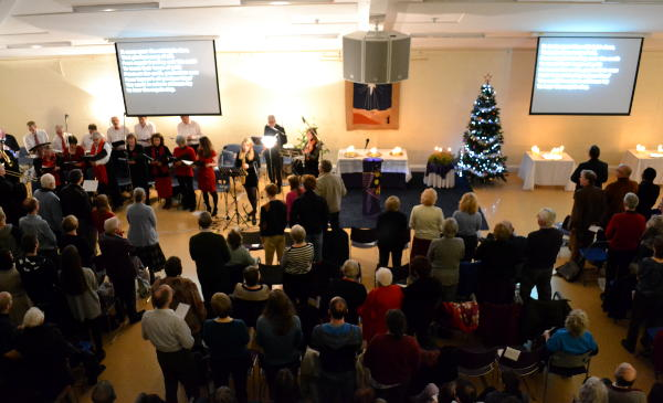 A choir leading a Carol service