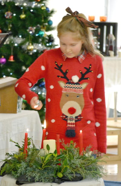 Lighting the candles on Christmas morning