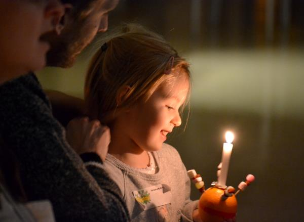 A lighted candle in a Christingle celebration