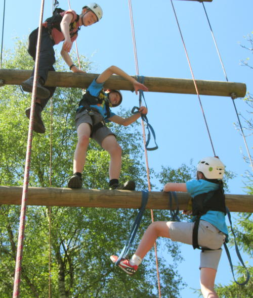 Climbing the giant ladder at Blackwell Adventure