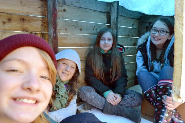 Four inside a slum dwelling