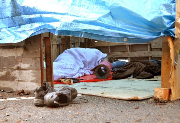 Asleep in a slum dwelling