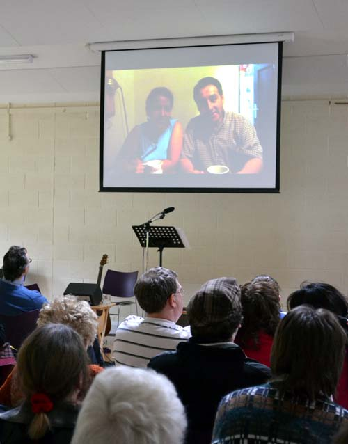 Christ Church members watching a video message on the giant screen