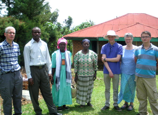 Family group outside a house in Chris Amulo's village