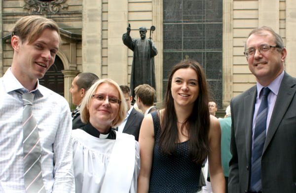 Megan with her family outside Birmingham Cathedral