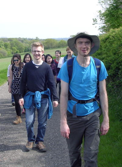 A group of people walking on a country path
