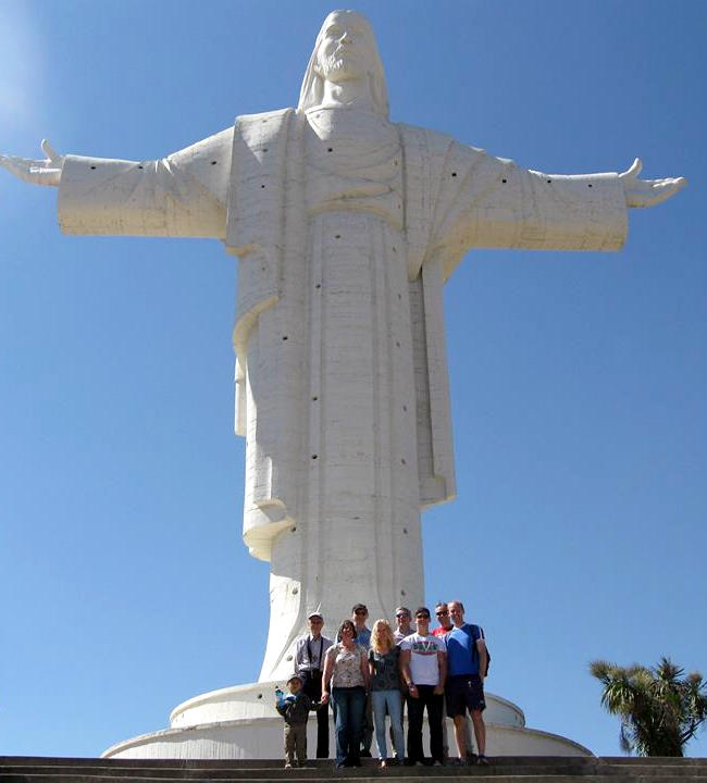 The team at the foot of the statue of Christ in Cochabamba, Bolivia