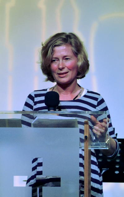 Judy speaking at a lectern