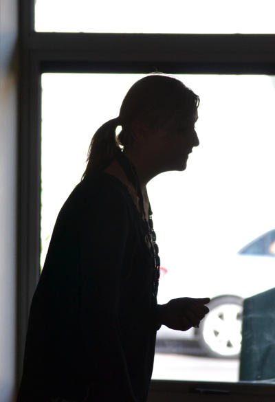 Ellen in silhouette: speaking at Messy Church