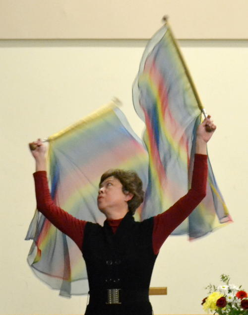 Michelle Samuel using flags in dance