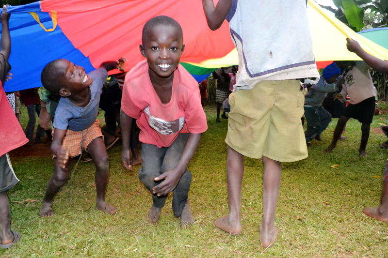 Teaching parachute games to children in Kenya