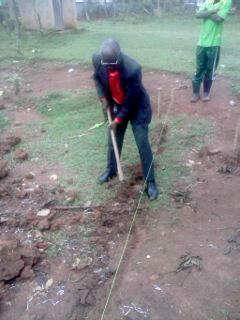 Archbishop Joram joins in the hard work