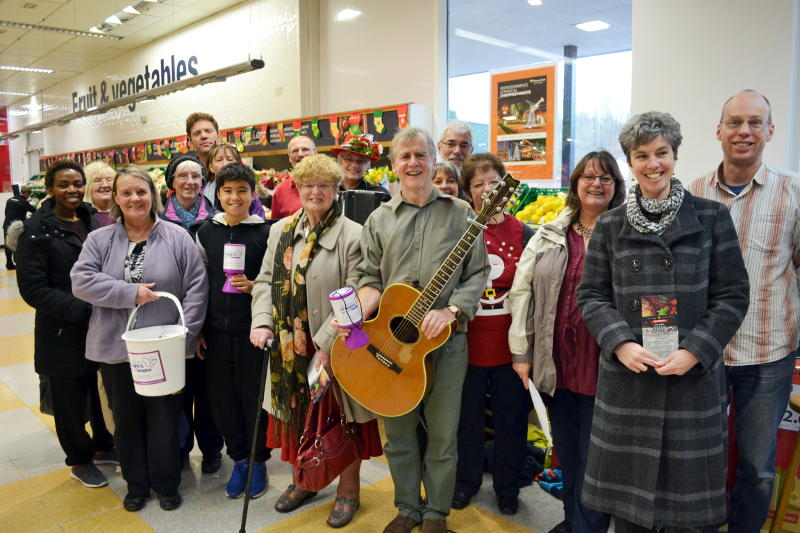 Carol singing in the Co-op