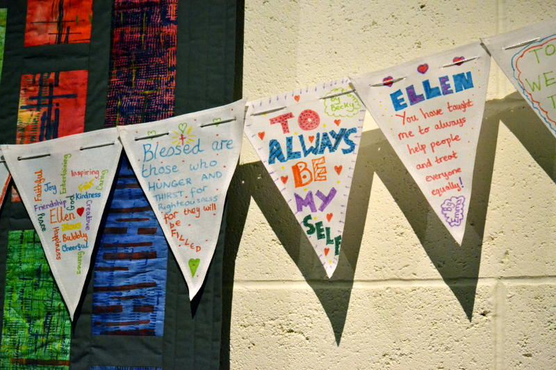 Triangular flags decorated with messages of thanks