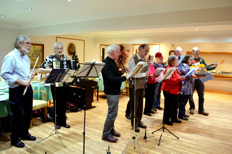 Carol singing at Neville Williams House
