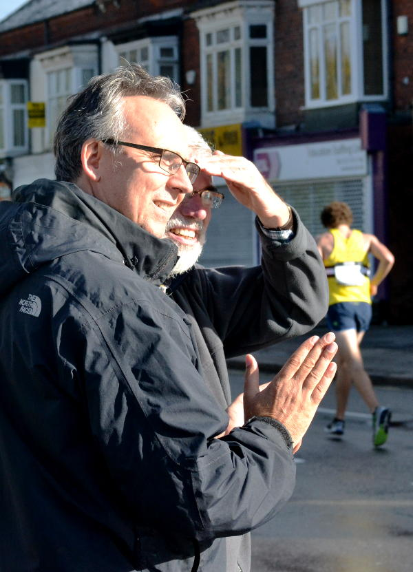 Vicar and former competitor Geoff applauds the runners