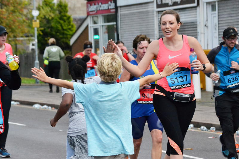 Waiting for a high-five from the marathon runners