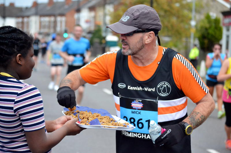 A runner picks up a piece of cake from a tray