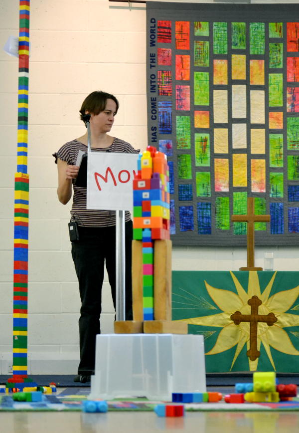 Rachel with a tower of Lego bricks
