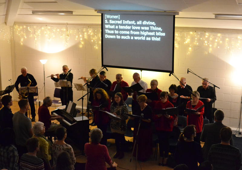 The choir leading singing at the Carol Service