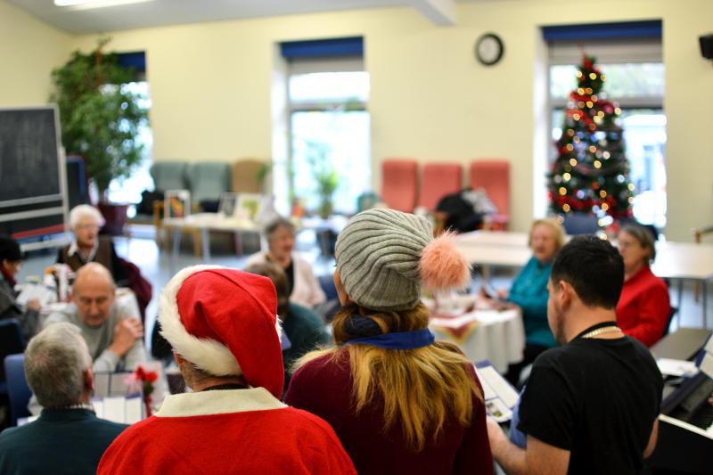 Singers leading Christmas carols
