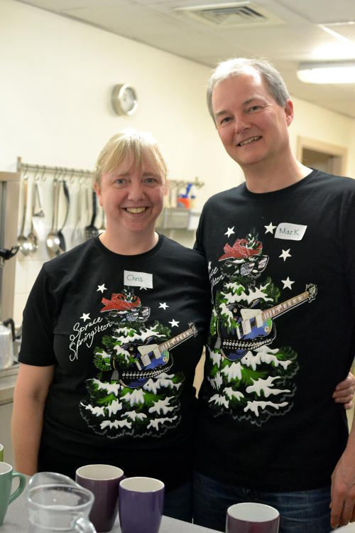 Serving drinks wearing Christmas T-shirts