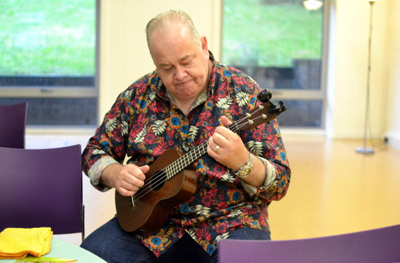 John Archer practising the ukulele