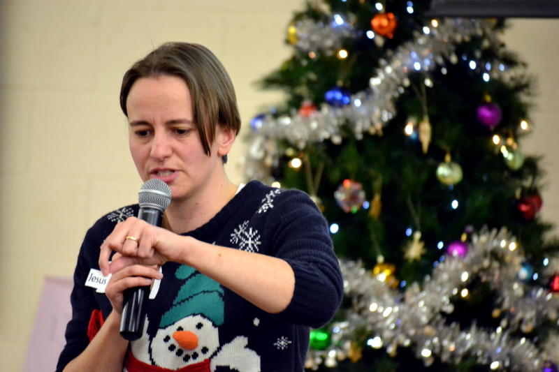 Rachel speaking in front of the Christmas tree