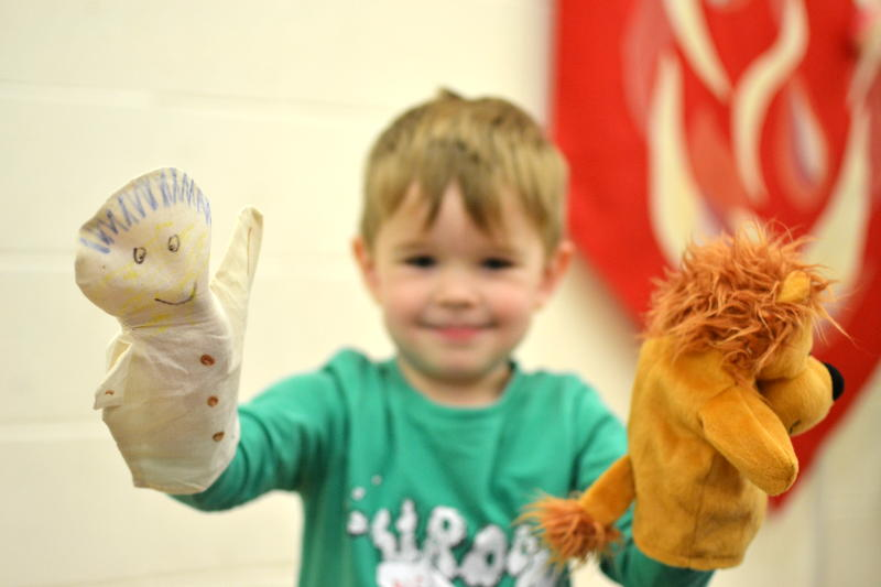 Playing with puppets at Messy Church