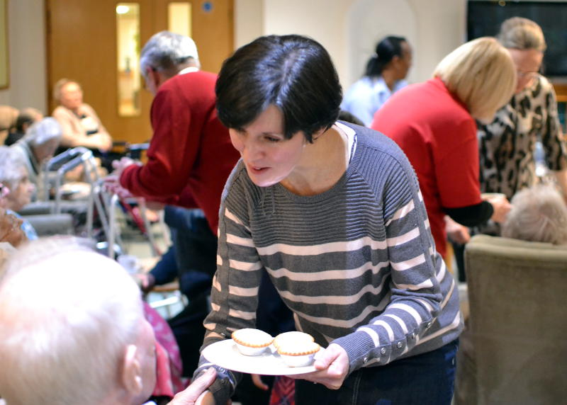 Serving mince pies after carol singing