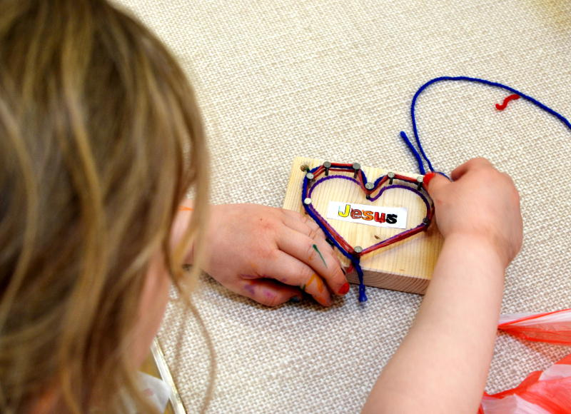 A message of love: wrapping yarn around a heart shape