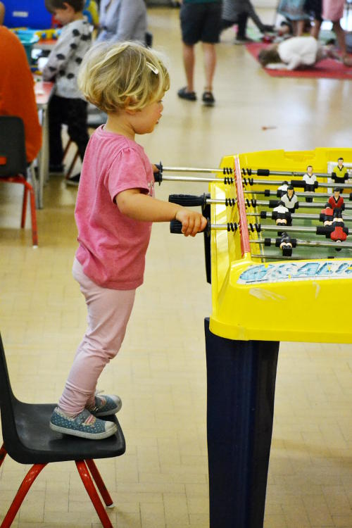 Standing on a chair to play table football