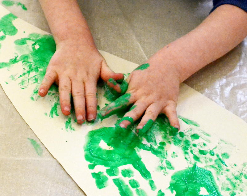 Hand painting with green paint