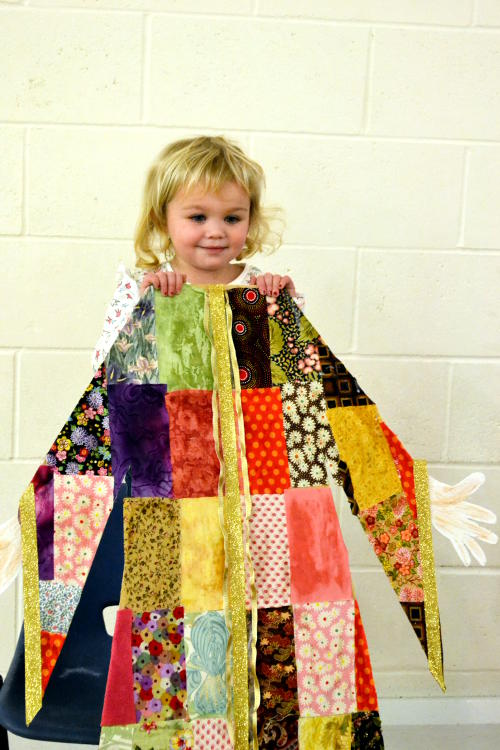 The completed coat of many colours/patterns