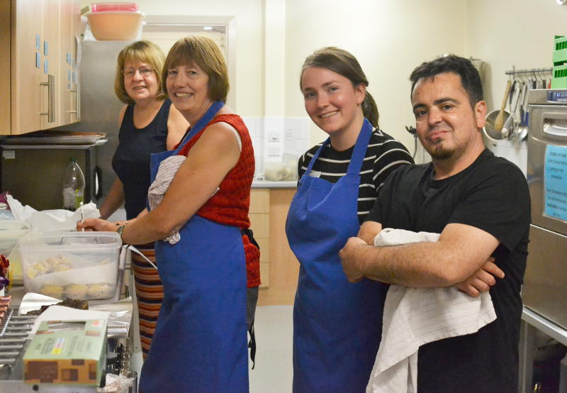 4 people at work in the kitchen