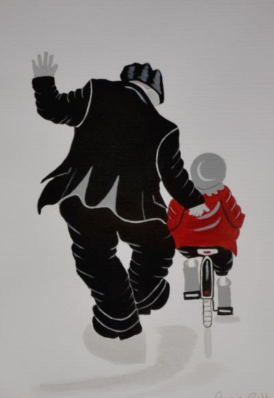 A man pushing a young child on a bike