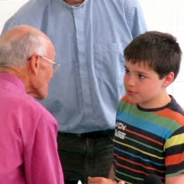 A boy tells the Bishop he is ready to be baptised