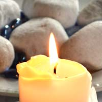 A candle is a symbol of prayer