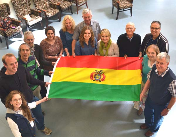 The Christ Church Bolivia team gathered around a Bolivian flag
