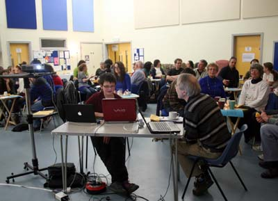 Discussion fills the hall at Café Church